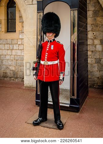 London, England - May 05, 2016 : British Royal Guard In Red Uniform At Tower Of London On May 28,201
