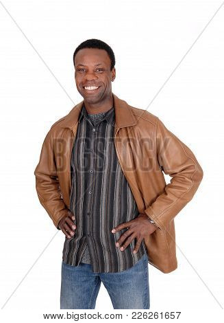 A Handsome Young African American Man Standing Smiling In A Brown Leather Jacket With His Hands On H