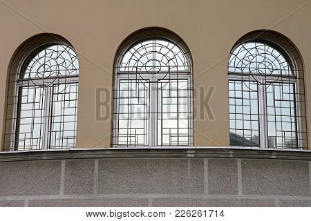 Three Arch Windows With Security Bars Building