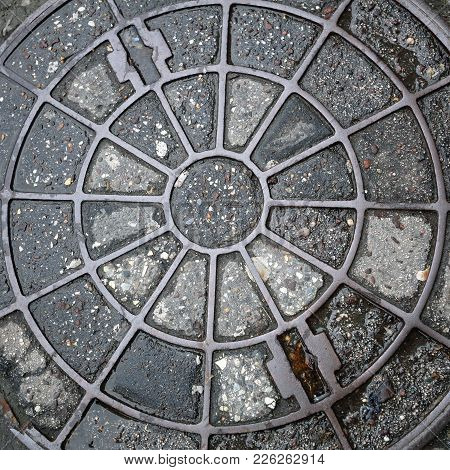 Concentric Circles At Manhole Cover Utility Shaft