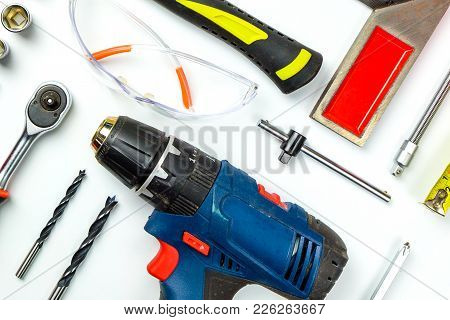 Set Of Construction Tools On White Background As Wrench, Hammer, Pliers, Socket Wrench, Spanner, Tap