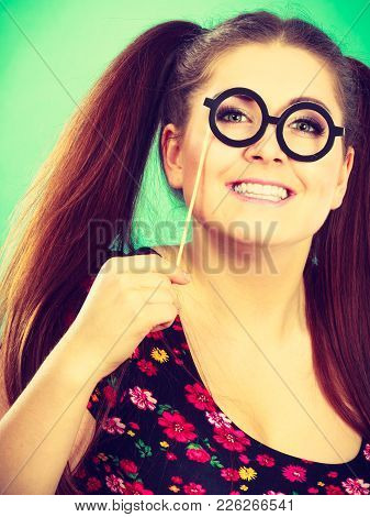 Happy Young Teenage Woman Holding Fake Eyeglasses On Stick Having Fun. Photo And Carnival Funny Acce