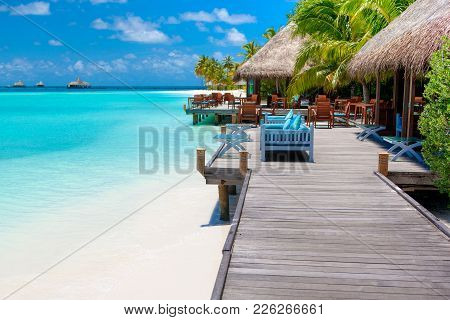 Chill Lounge Zone On The Sandy Beach In Maldives Island Over Indian Ocean