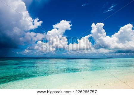 Beautiful Cloudy And Stormy Landscape Of Clear Turquoise Indian Ocean, Maldives Islands