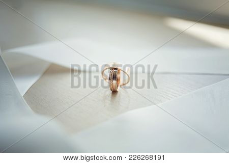 Panoramic Banner Of Two Upright Gold Wedding Bands Symbolic Of Love And Romance  For Your Greeting O