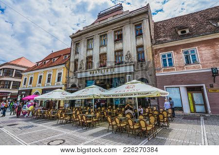 Brasov, Romania - July 5, 2016: Restaurant Tables And Parasols On Republic Street On The Old Town Of