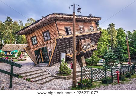 Szymbark, Poland - September 10, 2016: Exterior Of Wooden Upside Down House In Open Air Museum In Sz