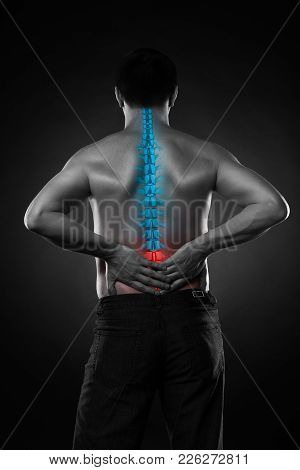 Pain In The Spine, A Man With Backache, Injury In The Lower Back, Black And White Photo With Highlig