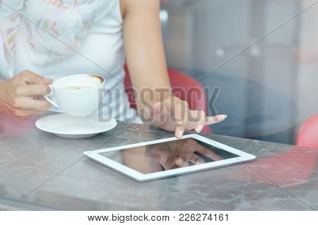 Woman Use A Touch Pad Screen While Standing In Cafe