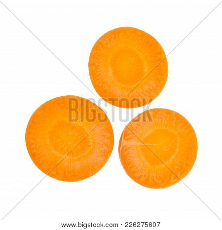 Close Up Top View Of Fresh Carrot Slice Isolated On White Background, File Contains A Clipping Path.