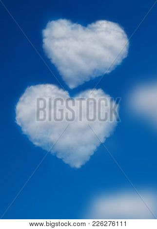 Two Heart Shape Clouds On Blue Sky. Concept Of Love, Valentine Day