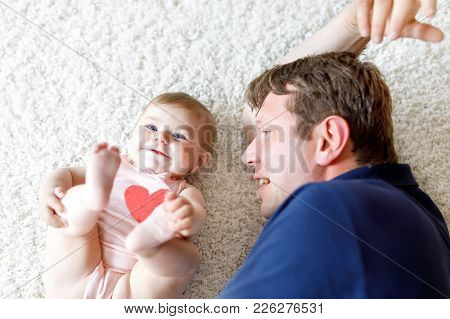 Happy Proud Young Father Having Fun With Baby Daughter, Family Portrait Together. Dad With Baby Girl