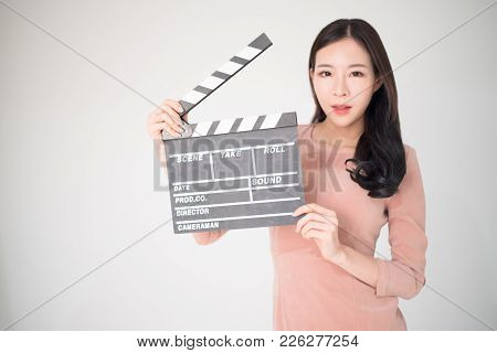 Sian Woman Holding Movie Clapper Board Isolated On White Background. Cinematography, Communication A
