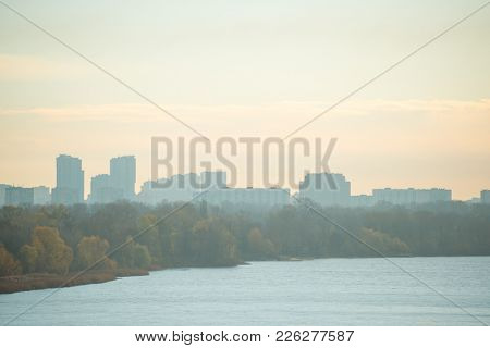 Panoramic Cityscape View of Kyiv and the River Dnipro in the Fog at Autumn Morning, Ukraine