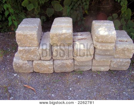 Stack of Large Cement Blocks Pavers