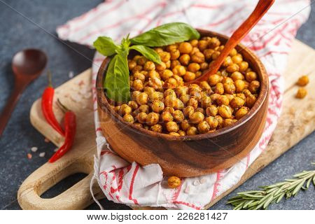 Healthy Snack - Baked Spicy Chickpeas In Wooden Bowl. Healthy Vegan Food Concept.