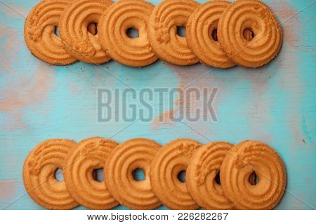 Pattern Of Butter Cookies/biscuits On Wooden Teal Green Rustic Background With Space For Text, Flat