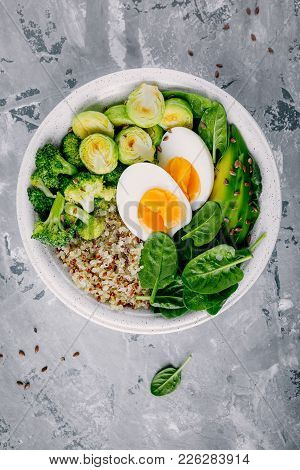 Healthy Green Vegetarian Buddha Bowl Lunch With Eggs, Quinoa, Spinach, Avocado, Grilled Brussels Spr