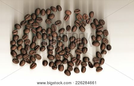 Coffee Beans Grade Arabica On White Background With Shadows