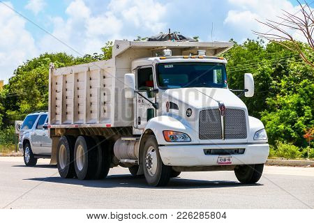 Quintana Roo, Mexico - May 18, 2017: White Dump Truck Kenworth T370 At The Interurban Road.
