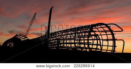 Bridge Pile Frames Wait To Be Used With A Sunset Sky.