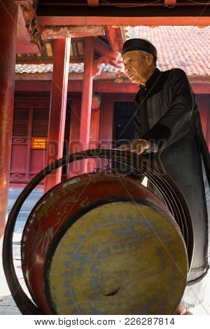 Hanoi, Vietnam - July 24, 2016: Old Man Beating Drum Made Of Wood And Water Buffalo Leather At Templ