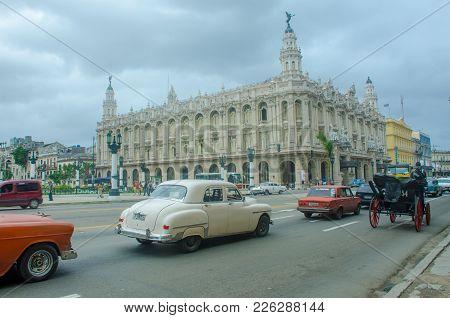Havana Cuba - 26 January 2018: Gran Teatro De La Habana- Great Theater Of Havana With Classic Cars I