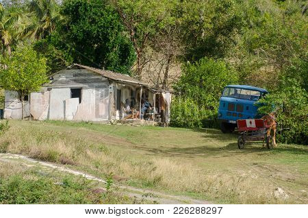 Jibacoa Cuba - 29 January 2018: Rural Scene In Cuba With Shack Truck And Cart