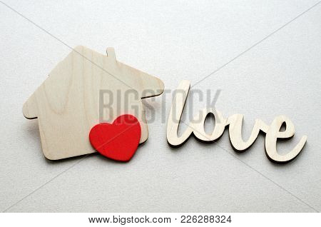 Wooden House, Red Heart And Word Love Over Paper Background, Happy Family Life Concept