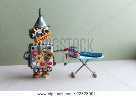 Robot Housework Assistant Ironing Blue Jeans With Iron On The Board. Green Wall Gray Floor Room Inte