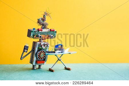 Robot Home Assistant Ironing Black Pants With Steam Iron On The Board. Yellow Wall Green Floor Room