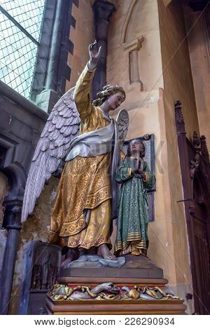 Bruges, Belgium - June 10, 2014: Beautiful Statue Of Angel, Interior Detail Of Church Of Our Lady In