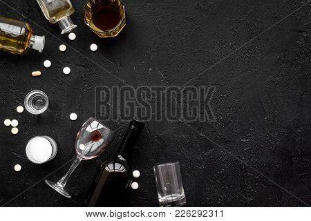 Alocohol Abuse And Alcoholism Treatment Concept. Glasses, Bottles And Medcine Pills On Black Backgro