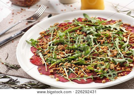 Beets With Peanuts On A White Wooden Background, Breakfast