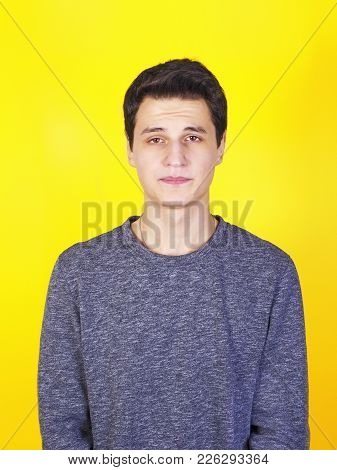 Confused Young Man Looking At Camera Shyness, Shame Or Humiliation Isolated On A Yellow Background.