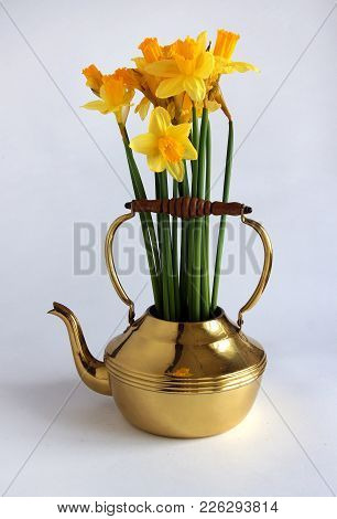Spring Bouquet With Daffodils And In A Brass Or Copper Kettle