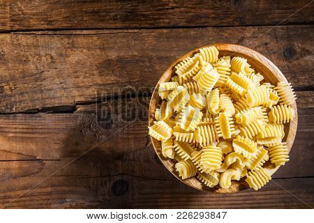Raw Pasta Radiatori In Wooden Bowl