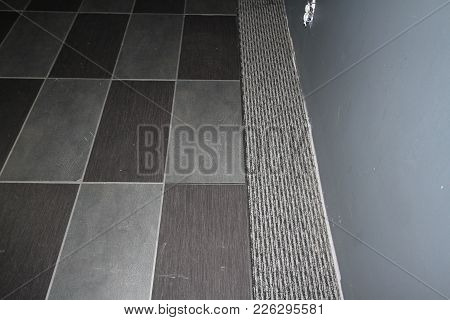 Carpet Tiles Imbedded Into A  Grey Carpet