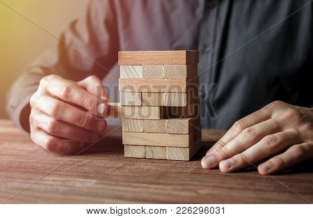 Property And Business Insurance Protection Concept. Insurance Agent Complete Wooden Model With Last