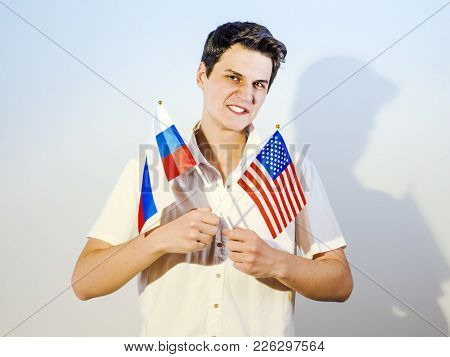 Evil Guy Holding Flags Of The Usa And Russia