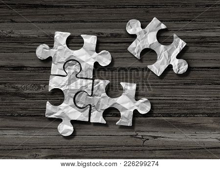 Puzzle Business Solution Concept As Crumpled Paper Shaped As Jigsaw Pieces Assembled Together With O