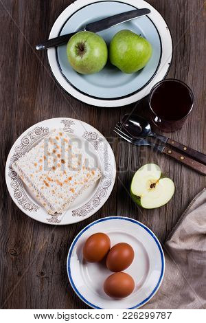 Ceremonial Foods On The Passover Holiday. Seder Table Ingredients: Matzo Bread, Hard-boiled Eggs For