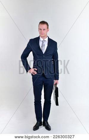 Concept Business People. Businessman On The Background. Businessmen Look Dastardly. Businessmen Show