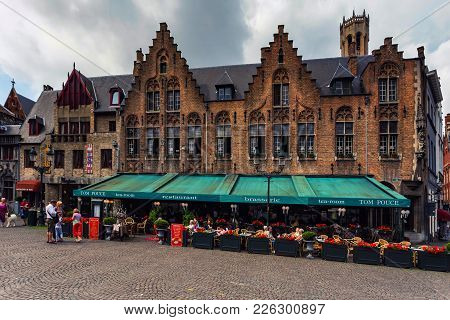 Bruges, Belgium - June 10, 2014: Outdoors Restaurant In Street In Bruges, Belgium. Bruges Is The Cap