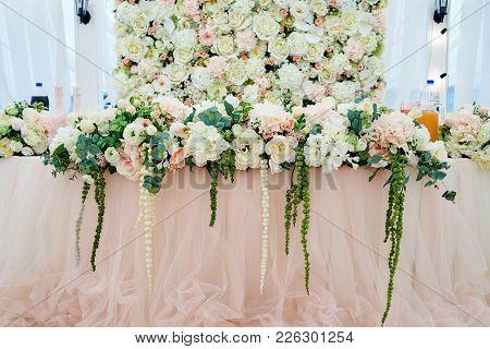 Lush Floral Arrangement On Wedding Table. Wedding Presidium In Restaurant, Free Space. Wedding Banqu