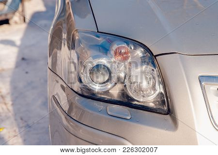 Headlight Car. Close-up Means For Light And Road Lighting.