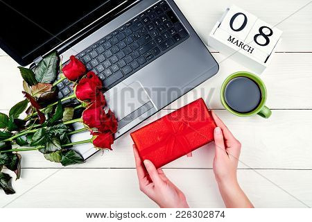Woman Holding Gift Box. Womens Day Background With Bouquet Of Red Roses; Gift Box, Calendar With Dat