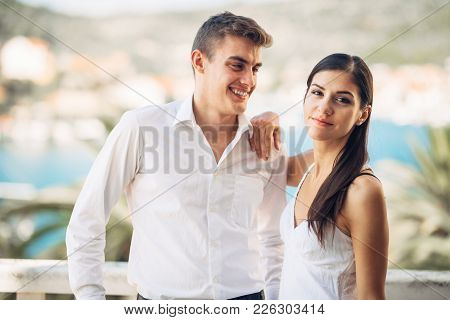 Young Couple Visiting Tropical Holiday Resort.honeymoon.couple Vacation. Woman Looking At Another Ma
