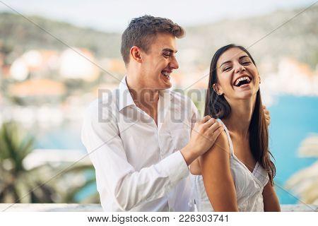 Loving Couple Spending Vacation On Tropical Island.newlyweds Honeymoon On Seaside Resort.true Love.c