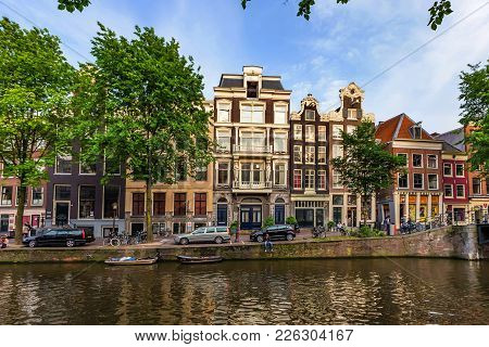 Amsterdam, The Netherlands - June 10, 2014: Beautiful Facades Of Canal Buildings In Amsterdam. Amste